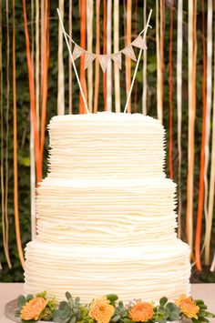 The gorgeous fall wedding cake with an adorable bunting cake topper! {Jennifer Baumann Photography}