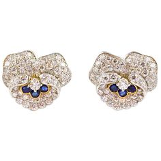 "TIFFANY & CO HEYMAN Diamond Flower Earrings Rare and very collectible ""pansy"" flower earrings by the collaborative work of Tiffany & Co. and Oscar Heyman, circa 1960s. They are designed to resemble pansy flowers, set with diamonds on a platinum setting and sapphires on 18K gold setting. Approx. 5.0cts of high quality pave set round diamonds and 0.25cts of sapphires."
