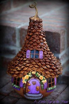 I like the idea of roofing fairy houses with pinecones. Cute...
