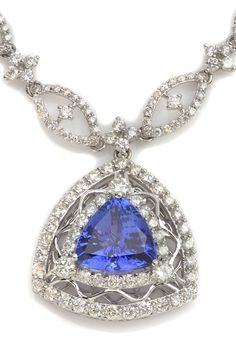 Wear this Blue Tanzanite Statement Necklace & you're sure to turn heads! Item #416-141716 Michael Christoff 6.39 ct Tanzanite Trillion & 7.20 ctw Diamond Round 18K White Gold Necklace Length 17 - Gem Shopping Network
