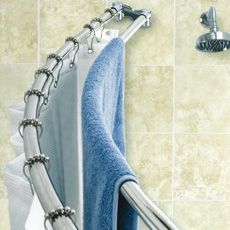 Hidden towel rack inside shower to catch drips in the tub and hide towels from guests.