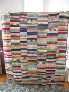 ...Now do you know what to do with all those little tiny strips of fabric?   I would cut the foundation strips from an old sheet, and just grab the strips out of a basket.......
