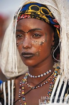 Fulani - There are 27 million of them in Africa but they're a minority because they're nomadic.They're a beautiful people but they don't  all look alike.Predominantly Muslim.