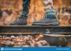 Photo about Forest railway, model wearing boots, man standing on rail. Image of railway, train, kitchen - 167642315
