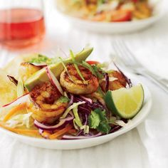 Chipotle Shrimp Tostadas | To create this Southwestern-inspired dish, Melissa Rubel Jacobson tosses shrimp with chipotle chile powder (made from dried, smoked jalapeños), grills them, then layers them on top of crunchy fried corn tortillas and crisp, citrusy slaw.