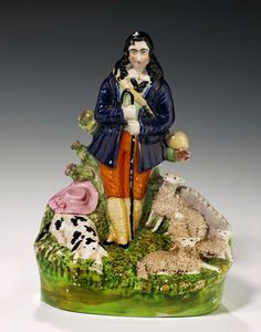 Staffordshire figure of a shepherd, dog, 2 sheep and lambs. 083514/2249