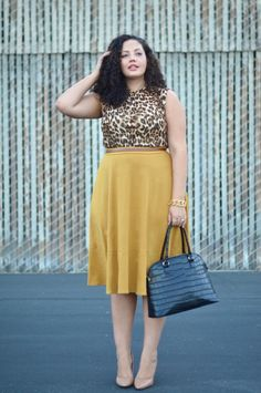 Faux leopard print blouse pleated mustard Colour skirt black bag nude pumps   Flaunt the curves Ladies