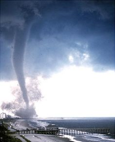 Tornadic waterspout travels ashore as a weaker tornado, causing minor damage to the coastal community. All Nature, Science And Nature, Amazing Nature, Earth Weather, Wild Weather, Tornados, Thunderstorms, Sprites, Tornado Pictures