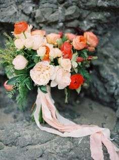 peach and coral bouquet featuring garden roses, ranunculus and berries by Wilder Floral Co.