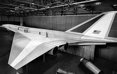 June 27, 1966: Lockheed SST mockup unveiled- Three technicians walk on the left delta wing of a full-scale mockup of Lockheed supersonic transport that stretches 273 feet from nose to tail. Description from pinterest.com. I searched for this on bing.com/images