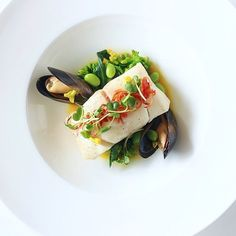 Slow cooked cod, saffron, black mussels... by @french_grill ⭐️ join our culinary community for free on cookniche.com and publish your recipes, photos, blogs, videos... Direct link in bio.