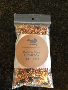 """A """"favor"""" that was given to each person that attended my father's funeral. Being a huge bird lover, we chose to honor his memory by asking family and friends to feed the birds! Small ziplock bags (2inX3in) and printing labels were purchased from Office Depot. It was treasured by all who attended!"""