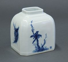 "Chinese Blue-and-White Porcelain Brush Washer with a short rectangular neck above sloping shoulders and a body with canted corners, decorated with bird and flowers, one of the lower right corner marked 'Wang Bu' and the base marked 'Yuan wen wo guo zhi zhai', 4.75""h"