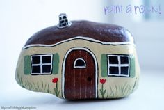 Mini House painted rock.  Picture found at: craftylittlepigtails.blogspot.com/