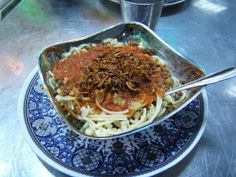 A staple of the everyday Egyptian diet, Kosheri is a vegetarian blend of macaroni, rice and lentils topped with fried onions, lemon juice and spicy tomato sauce. Whether you buy it in a café or prepare it home, Kosheri is cheap, simple and fast.  Kosheri restaurants and mobile Kosheri vans can be found in every Egyptian city. Kosheri restaurant menus are remarkably minimal and usually contain just three options: small, medium or large.Typically rice pudding is served for desert.