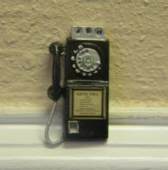 Hey, I found this really awesome Etsy listing at http://www.etsy.com/listing/91755763/rotary-pay-telephone-dollhouse-miniature
