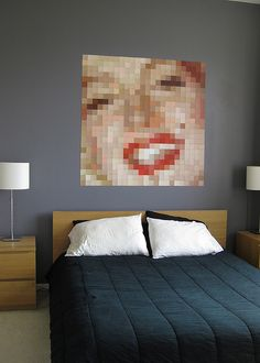 "LOVE THIS IDEA!  Using paint sample cards, pixelate a picture in photobucket and using the paint cards, make this awesome piece of art in your home!  Google ""how to pixelate a picture"" if you don't know how!"