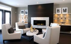 don't like the white around the fireplace - but the black looks great - maybe if we can find that stone in grey? Also, love the chairs!!!