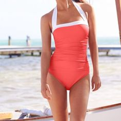 Ralph Lauren Swim Suit in Coral NWT Ralph Lauren Bel Aire in Coral. Halter style with ruching. Comes from pet and smoke free home. Thanks for looking! Ralph Lauren Swim One Pieces