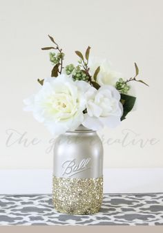 Glitter dipped mason jars are the perfect, messy spring table decor DIY.