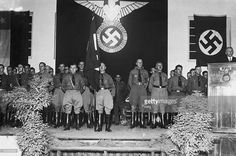 A meeting of the Chilean Nazi party, circa 1940. Present at the meeting are: German industrialist Count Matuschka of the Siemens-Schuckert company, Walter Stanke, Herr von der Werth, and Otto von Zippelius, a former military instructor in Chile.