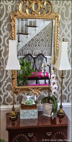 Gold mirror, geometric wallpaper, fabulous tall and shapely lampshades