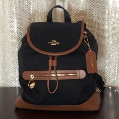 Selling this NWT Coach Sawyer Backpack Black in my Poshmark closet! My  username is  bbb3cc6aec