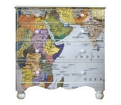 Covering furniture in map wallpaper