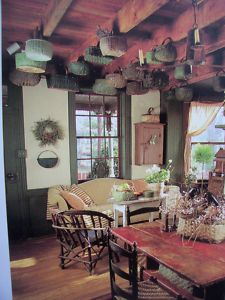 i have beams like this in my house . . . i love the idea of hanging baskets off of them!!