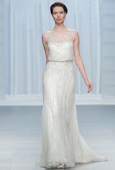 Brides.com: . Sleeveless sheath with an illusion neckline and art deco beaded embellishment, Rosa Clará