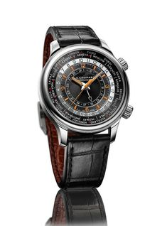 The Chopard L.U.C Time Traveler One is shown here in stainless steel, with a sunburst, satin-brushed black dial and orange accents for the hands, hour numerals and hour markers; this version's 24-hour ring is divided into slate gray for nighttime hours and silver-tone for daytime. More @ http://www.watchtime.com/wristwatch-industry-news/watches/gentleman-travelers-chopards-new-l-u-c-gmt-one-and-time-traveler-one/ #chopard #watchtime #watchnerd #menswatches