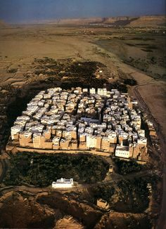 """""""Shibam, a town in Hadramawt, Yemen, is considered to have the world's oldest skyscrapers. All of the town's houses are made out of mud bricks. While Shibam has existed for around 2,000 years, most of the city's houses come mainly from the 16th century."""" Photograph by Pascal and Maria Marechaux."""