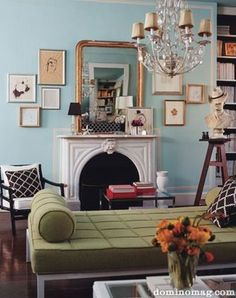 Green couch, blue walls.
