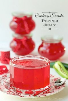 Cranberry Sriracha Pepper Jelly - this stuff is crazy good! We love it spooned over cream cheese and served with crackers but it also makes a wonderful glaze for chicken, pork, salmon, etc.