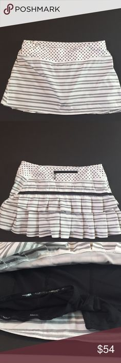 Lululemon pace setter twin stripe black mod polka Lululemon pace setter twin stripe black mod polka dots. Excellent condition!  Love this skirt! Size 8 lululemon athletica Skirts