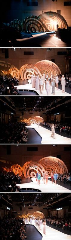 the architecture of the ocean brought to the fashion runway. marine-themed. tunnel. walkway. showcase. staging backdrop.    The models made their way from the chamber of the triton shell out onto the blonded boardwalk, past the island & do