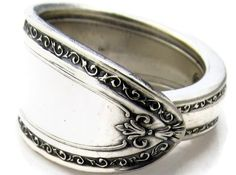 """NO """"Spoon ring"""", but I do like the details in the scrollwork of the outer border (without a talon theme) and the aged/used finish gives it charm. However after looking at this several times I was intrigued. If our ring were to broaden at some point or even have a mock overlay like this spoon ring does it would allow us to introduce a  H if we choose. Am I getting too much on one ring? Will it start to look tacky or gaudy? Regardless I know I want a continuous and smooth inside to the ring."""