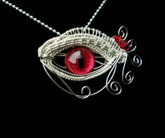 Wire Wrap - Red Egyptian Dragon Evil Eye 1 by ~LadyPirotessa on deviantART    I hope I can get to the point where I can do this.