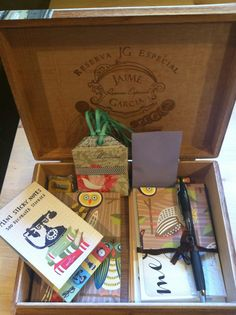 Writing Box #1. A cigar box repurposed as a writing box! Packed with fresh #2 pencils, a new pen, a selection of stationery and whimsical office supplies. The perfect box for stashing postcards and stamps or perhaps love-letters? Donated by Rebecca Feind.