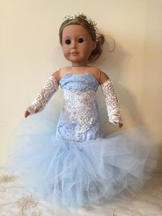 Gorgeous and OOAK blue bridal lace created gown in mermaid style. Front is embellished with bridal trim, comes with Pearl and Crystal crown/Headband and lace arm sleeves. Stunning set