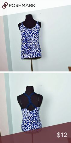 Gorgeous Blue Leopard Print Blouse In excellent condition. Silky soft, sexy, and comfortable! Buy 3 items, get one free plus 15% off your purchase total! Tops Blouses