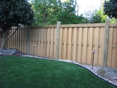 Wood shadowbox fence with capped posts | Mossy Oak Fence Company, Orlando & Melbourne, FL