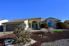 3 bedrooms / 2 bathrooms / AbqMoves.com / 1,859sqft / 6557 Blue Quail Road NE- TWO living areas with VIEWS! (Rio Rancho, NM) / Mike Bigelow 505-688-5363 / How much is your Rio Rancho, NM house worth? / Homes for Sale Rio Rancho NM / Bigelow Real Estate 505.899.0345