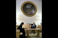 President Barack Obama talks on the phone with Tara McGuinness, Senior Communications Advisor, for an update on the Affordable Care Act, at Villa Madama in Rome, Italy, March 7, 2014. At left is National Security Advisor Susan E. Rice. (Official White House Photo by Pete Souza)
