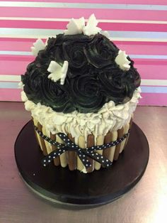 See 2 photos from 6 visitors to Cupcake Couture. Cupcake Couture, Giant Cupcakes, Rose, Desserts, Black, Tailgate Desserts, Pink, Deserts, Black People