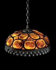 Tiffany Studios ''TURTLEBACK TILE'' CHANDELIER shade stamped TIFFANY STUDIOS/NEW YORK leaded glass and patinated bronze 88 1/2 in. (224.8 cm) high with ceilng cap and chain 23 3/4 in. (60.3 cm ) diameter of shade ca. 1910