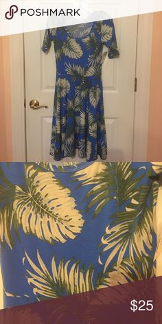 LulaRoe Nicole LulaRoe Carly. Never worn - tags attached.  Beautiful blue and green leaf pattern. Size Small. Free gift with purchase! LuLaRoe Dresses Midi