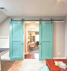 Turquoise barn doors.....would love to do this in the next house.