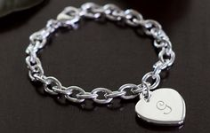 with a b for bryan <3  http://www.simplypersonalized.com/engraved-gifts/engraved-jewelry/heavy-weight-charm-bracelet/