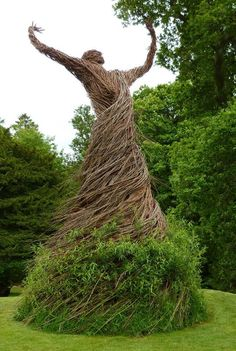 Living willow statue in a walled garden in Scotland